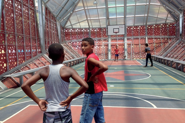 A 200m² indoor court for children on the top floor of Carbonell, a compact multi-sport and cultural complex situated in the Lomas de Urdaneta favela in Sucre Parish, Caracas.