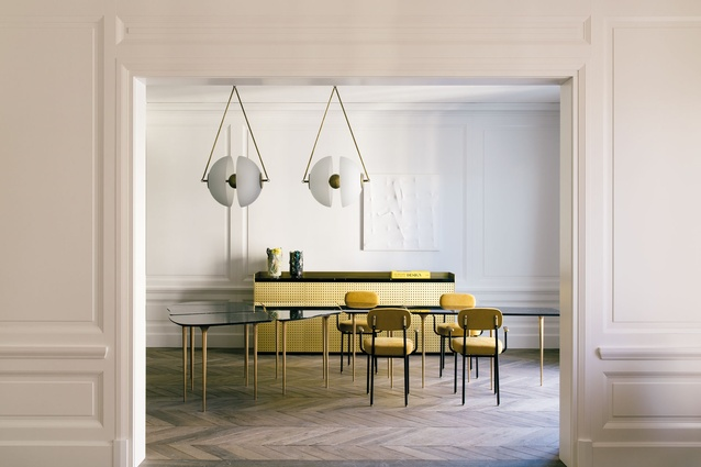 The dining room's yellow and white colour palette is offset by the natural oak parquet flooring.