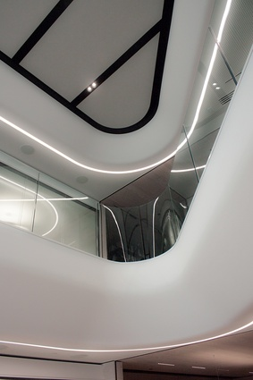 The chamfered, curved line of the stairwell's bulkhead increases the fluidity of the 