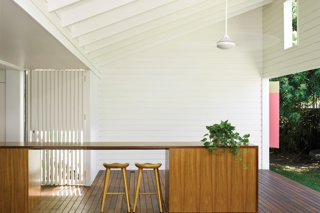 The kitchen bench extends into the outdoor room on the northern edge of the site.