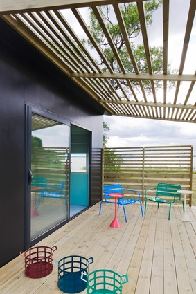 With its summer-ready deck, it's not hard to imagine the Mini House sitting on a local beach.