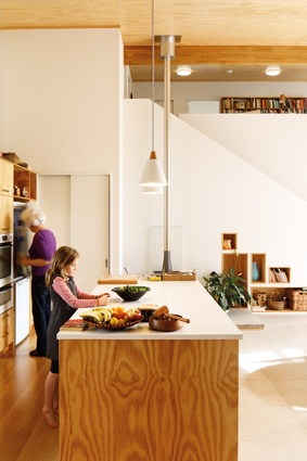 A custom-made kitchen is a focal point of the main living space.