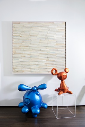 Given one of the owner's profession as an art gallerist, various works of art are thoughtfully placed throughout the interior.