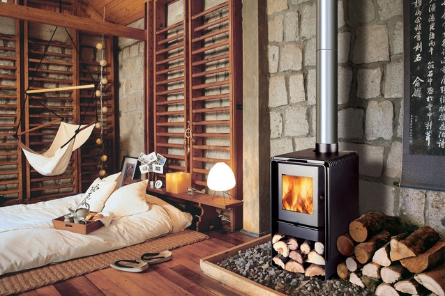 """<a href=""""http://www.bosca.co.nz/wood-fires/firepoint-360"""" target=""""_blank""""><u>Bosca Firepoint 360 wood fire</u></a> is a Kiwi classic: an affordable and compact log burner designed to fit into smaller spaces."""