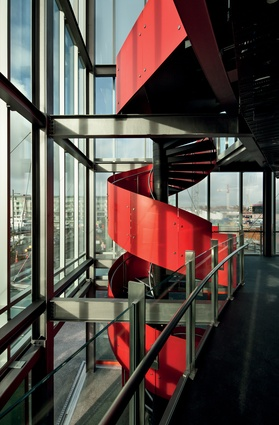 A vivid red spiral staircase carries patrons up to the first level.