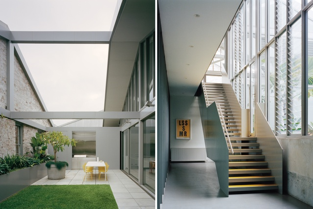 The terrace was formed by removing part of the original roof; a yellow poster print by Studio Boot hangs downstairs.