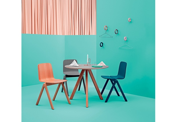 Design Junction: Gymnast-inspired coat or towel hooks in mint, coral or grey, by Hay at Lost and Found. The Hay Copenhague table and chairs are designed by Ronan and Erwan Bouroullec.