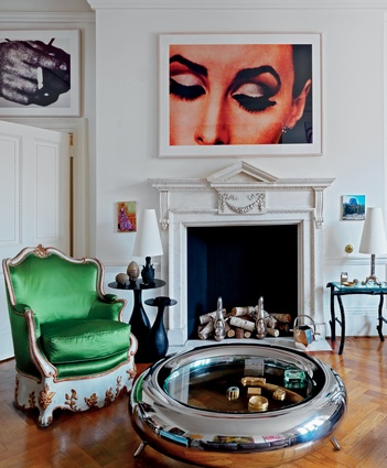 Green armchair by Emilio Terri for Carlos de Beistegui and Garouste & Bonetti coffee table in the living room.
