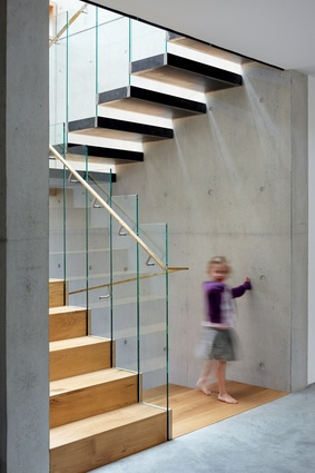 A glass balustrade enhances the sculptural quality of the main staircase.