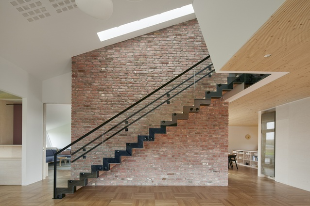 There is a double-height large brick wall in the atrium that creates a homely feel, while also stabilising the temperature through its thermal effect.