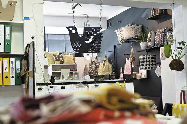 Upstairs is home to the designer's office and a workroom for her seamstresses.