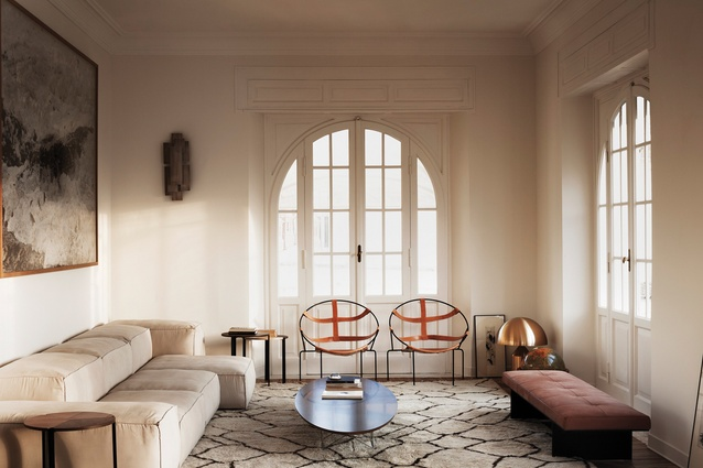 Lounge with Flavio de Carvalho's leather chairs, a Berber carpet, Living Divani sofa, furnishings and art that complement the classic architecture.