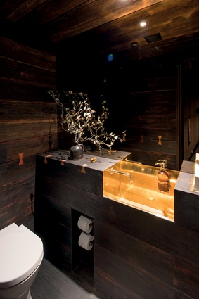 The bathrooms feature brass washbasins and handpainted tiles.