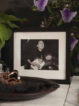 """Childhood photograph: """"This is my favourite photograph: my mama, sister and me at my mama's surprise 40th birthday. It captures a moment of pure joy. I find it very comforting."""""""