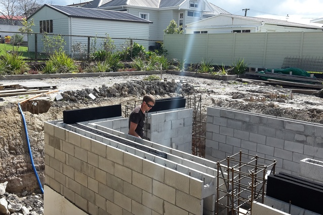 Joel working on the basement while the Autex insulation is being installed.