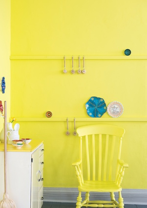 Farrow & Ball's Yellowcake on this kitchen wall adds interest to rooms dominated by chrome or white appliances. Similar citrus yellows are Resene's Headlights and Dulux's Fort Street.