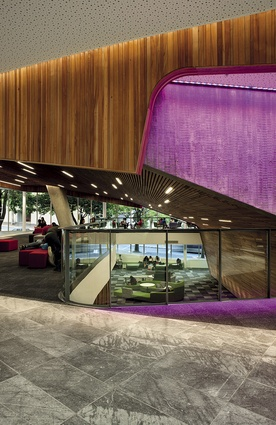 A huge floor-to-ceiling glass wall creates 