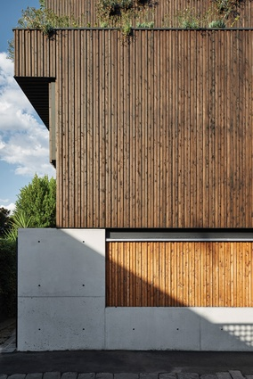 The house's stepped form accommodates planter ledges that provide an important softening of the facade.