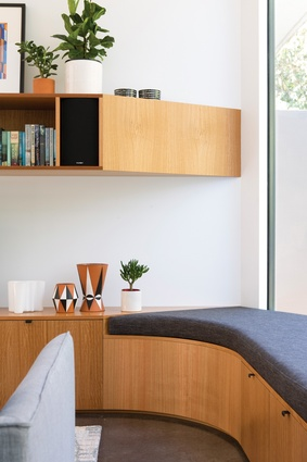 The curving form is continued into joinery details in the living space.