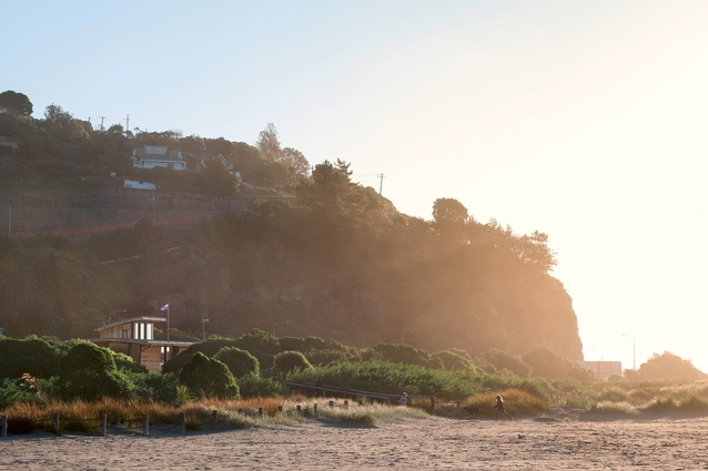This idyllic beach scene also carries the narrative of coastal devastation caused by the 2011 Canterbury earthquakes. Sumner Surf Lifesaving Club has operated surf patrols at this location since 1911.