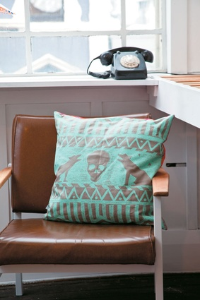 Pugh  was given this Evie Kemp cushion as a studio-warming gift by the maker.
