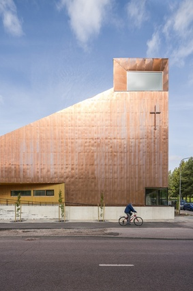 The copper-clad Suvela Chapel by OOPEAA, 2016. A flexible, multifunctional building that welcomes all members of the community, regardless of their religious affiliation.