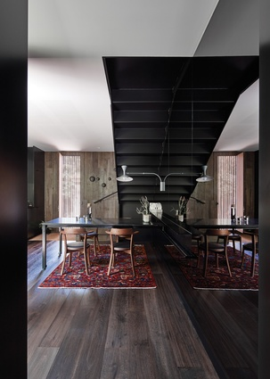 A built-in dining table that slides along a track can be effortlessly moved out of the way to create more floor space.
